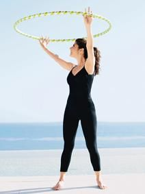 Standing Twist with hula hoop.  Works abs. Repeat twisting from left to right for 1 minute.  Celeb Workout: Marisa Tomei Hula Hooping - Shape Magazine