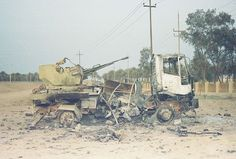 Destroyed Iraqi vehicle. Think this was near Al-Numaniyah. April 2003.