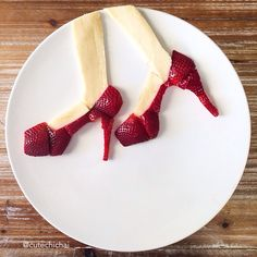 Food Art. Red heels--made with strawberries and banana. I can no longer walk on these but I can definitely make them and then eat them:).