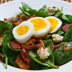 Spinach Salad With Bacon, Caramelized Onions, Mushrooms And Blue Cheese In A Bacon Pan Sauce Dressing Topped With A Hard Boiled Egg (via www.foodily.com/r/lQgVTf9e8) -dt
