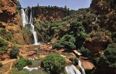 """Ouzoud Waterfalls (110 m high) are located near the Moyen Atlas village of Tanaghmeilt, in the province of Azilal, 150 km northeast of Marrakech, in Morocco. Ouzoud means """"the act of grinding grain"""" in Berber. This seems to be confirmed by the frequent mills in the region."""