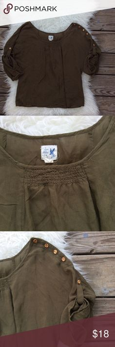 Edme & Esyllte Olive Loose Blouse Good condition Edme & Esyllte olive green blouse from Anthropologie. Size XS. 100% rayon (super soft feels like cotton) Sleeves roll up and button above the elbow. Left shoulder has wooden buttons. Loose fit with wide scoop Boatneck. Small bleach spot shown in last photo. No trades, offers welcome. Anthropologie Tops Blouses