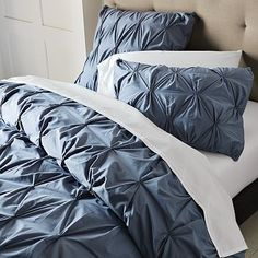 I usually have a hard time with bedding, but I really like this color and look!