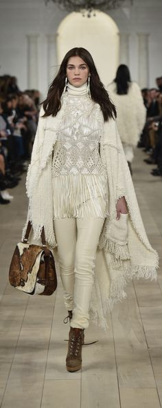 Ralph Lauren Collection Fall 2015: A cream soft boucle cape and antique embroidered crotchet top worn with a spotted haircalf double flap shoulder bag