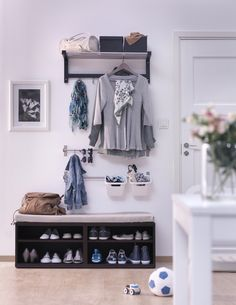 I like the bench with shoe storage and the Ikea wall mounted rods with baskets. (for mail)
