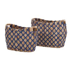 "Net worth: A pair of woven rush baskets over an iron frame is decorated with royal blue paper rope. Product Description • Product Dimensions: 15 - 17"" H x 11.75"