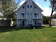 Back view of three story Lakehouse Lake Michigan, Vacation Rentals, Open Concept, Shed, Outdoor Structures, Cabin, Mansions, House Styles, Home