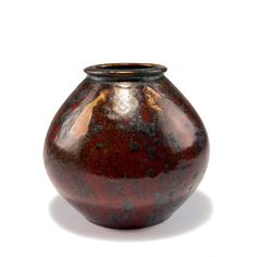 Pierre-Adrien Dalpayrat, Bourg-la-Reine. Vase, c1905. H. 15.3 cm. Stoneware, oxblood red and green high-firing glaze, metallic. Marked: Dalpayrat, 2075, 'lion's paw'.
