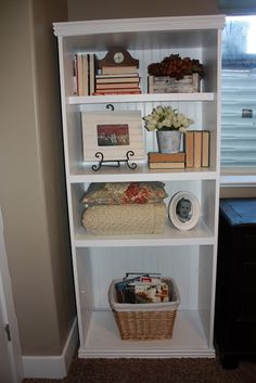 dress up an inexpensive bookcase with some beadboard wall paper.  Add some trim board if desired.  Looks great.