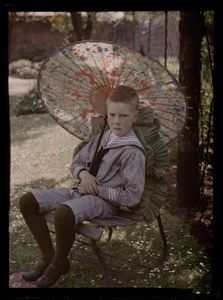 Boy with parasol, c.1908 The vast majority of photographs are taken by anonymous photographers and the Autochrome process was no exception to this rule. By 1913, the Lumiere factory was making 6,000 Autochrome plates a day.Most Autochromes were taken by amateur photographers, attracted to the process by the novelty of colour, combined with its relative simplicity.