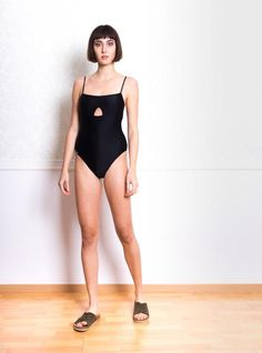 Styga Swimsuit With Cut Out in Black. One Piece, Swimwear  80% Polyamide 20% Nylon Available in S, M, L, XL