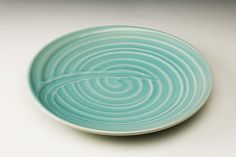 a celadon plate with 'fingerpattern' by Malcolm Greenwood