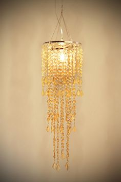 "Tier Cascade Faux Chandelier-- living room, either in front of curtains or in the corner above the ""reading"" chair."