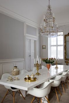 Gray & white dining room. Love that chandelier!