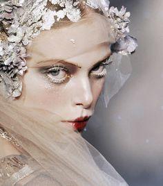 Bridal fashion week wedding dress traditions; designer John Galliano wedding veil details, lace and pearls