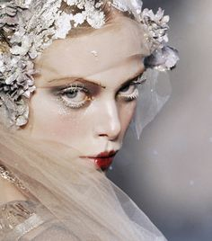 Bridal fashion week wedding dress traditions; designer John Galliano wedding veil details, lace and pearls