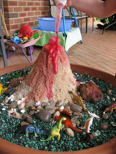 Dinosaurs are a popular part of Montessori lesson plans. To engage in some dinosaur discussions i made up this Dino land. The base is a ter. Volcano Projects, Dinosaur Projects, Dinosaur Crafts, Dinosaur Party, Dinosaur Land, Dinosaur Garden, The Good Dinosaur, Dinosaur Diorama, Dinosaur Display