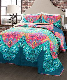 This set's vibrant quilt features a bright design that adds a touch of boho-chic style to your bedroom. Complete the look with two matching shams.