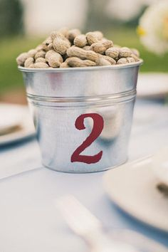 Incorporate your favorite snack in your table numbers to hold wedding guests over until the main course arrives!