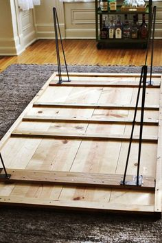 4 long planks for the top, 9 smaller planks bracing and framing the bottom, and 2 longer small planks to frame the outer edges. We used mostly pine (because it is pretty and affordable) with a few oak pieces among the 9 s
