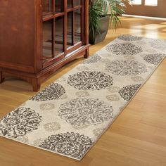 <p>Lay out the foundation for a beautiful, traditional ensemble in your home with this gorgeous area rug by Three Posts.</p><p> Covered in an artistic medallion design in ivory and complementing neutral hues, this gorgeous polypropylene rug made in the USA instantly adds pattern, dimension, and warmth to any space.</p><p> Roll it out in your classic kitchen ensemble to elevate a bistro dining set, and then complem...