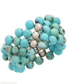 Densely packed beads of Blue-Green Magnesite and Sterling Silver form an oh-so-chic Stretch Ring. One size fits most.