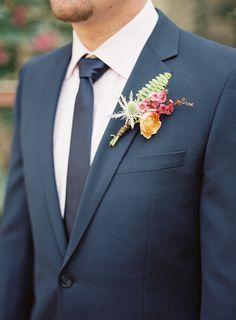 Dark blue suit and lovely boutonniere @myweddingdotcom #myweddingmag