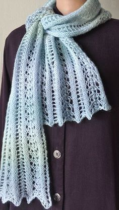 Just love the shade of blue on this simple to knit lace scarf. Free pattern.