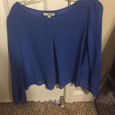 UA top-- never worn, tags still on Brand new, tags still on, size medium UA top. Flowy, long sleeved Tops Blouses