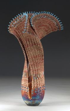 "WB 988 RAIN ON THE RIDGE.  25"" h x 15"".  Raku pottery lined with copper leaf (3 slots), dyed seagrass, rattan, silver-plated colored, copper wire, copper mesh, lapis lazuli beads.  By Marc Jenesel & Karen Pierce"