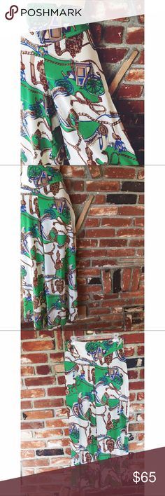 """Vtg 90s Palazzo Novelty Print Wide Leg Pants M These are gorgeous palazzo wide leg Novelty print pants size medium. Side zipper. Made by best collection by Elias. 100% rayon material that feels like silky hand wash cold and hang dry. Belt loops. Measured laying flat: waist 15.5""""/ hips 22""""/ inseam 30""""/ rise 11""""/ pant length 41.5""""/ leg opening 13."""" Gently used and in great condition. 070917 vintage Pants Wide Leg"""