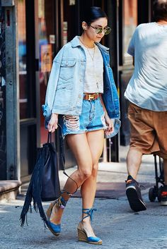Vanessa Hudgens in Wildfox Dakota sunglasses, crop top, Hermes belt, and cutoff denim shorts