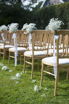 Aisle chairs with gypsophila posies and ribbon - Image by Source Images
