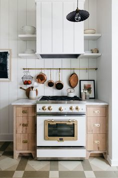 Vintage style stove in eclectic kitchen with patterned floor