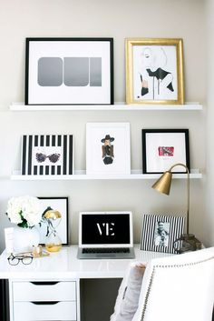 Leaning, feminine art in work space with various frames