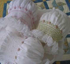 I  This darling bonnet is made of easy care cotton batiste...smocked with DMC embroidery floss....adorned with seed pearls and handmade $29.95