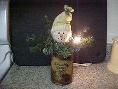 Primitive Christmas  Soup can snowman - oddly cute!