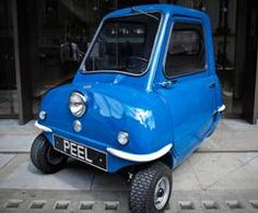 World's smallest car,  one door, one headlight, just enough room for one person and a shopping bag