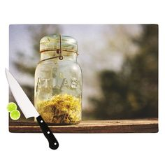 Kess InHouse Angie Turner 'Jar of Sunshine' colored Country Cutting Board