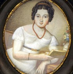 French School, A young woman with a book, ca.1820