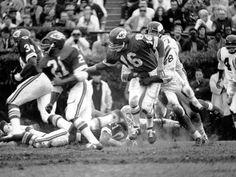 Super Bowl IV (Chiefs 23, Vikings 7): Kansas City quarterback Len Dawson is grabbed by a Minnesota defender after handing the off to running back Mike Garrett.