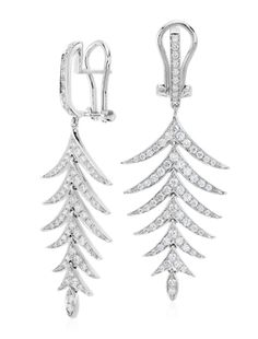 Dramatic in design, these drop earrings feature round pavé-set diamonds set 18k white gold. They make an unforgettable gift for your special someone!