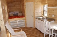 There is a full bath tucked in the corner behind the white door. 198 Sq Ft Tiny house For Sale 003