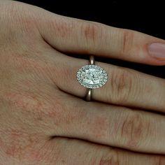 Oval Diamond Halo Modern Platinum Engagement Ring via Etsy