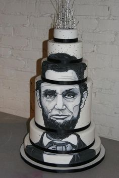 The Lincoln by White Flower Cake Shoppe.  Amazing!!!  An interesting wedding cake theme for sure.