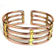 Copper and Brass Window Cuff - Brass Images. Handcrafted by South African artisans, this strikingly simple cuff bracelet of polished copper and brass bars is inches wide. Copper Cuff, Copper And Brass, Copper Jewelry, Fashion Bracelets, Cuff Bracelets, Fashion Jewelry, Bracelet Display, Fair Trade Jewelry, Window