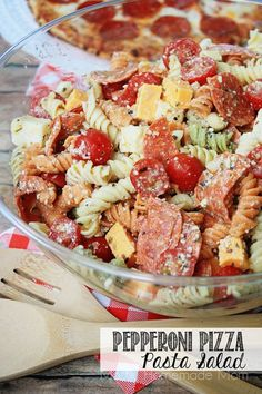 Tri colored rotini pasta with pepperoni, mozzarella, cheddar, and tomatoes in a Parmesan vinaigrette. This is the perfect summer side dish recipe!