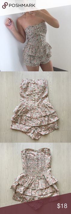 FOREVER 21 FLORAL ROMPER FOREVER 21 - HERITAGE FLORAL ROMPER  This super adorable romper is great for spring and summer. Ruffle accents and pearlescent buttons makes for the perfect feminine outfit!   Back zipper enclosure Forever 21 Pants Jumpsuits & Rompers