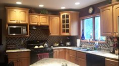 Painted kitchen cabinets to give them a custom look. Original cabinets. New and improved with Annie Sloan!