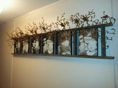 Tobacco stake ladder with vine and stars and 5x7 photos when I was a baby. Cheap!!
